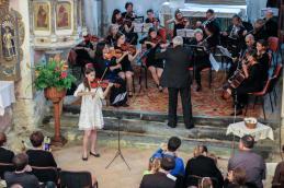 Z Lucijo Čemžar pri violini in Mišom Frelihom ob orglah smo izvedli delo T. Albinonija, Adagio.